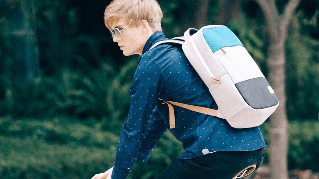 Young Man Wearing Nifteen Backpack